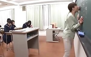 Japanese teacher gives a opportune lesson before blackboard