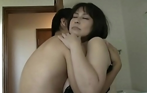 Mature beautiful Asian with big tits copulates with a young pauper