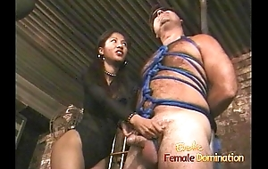 Comely Asian bitch enjoys pleasuring bound and blindfolded waxen stud
