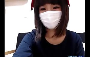 Cute japanese girl undressing before webcam